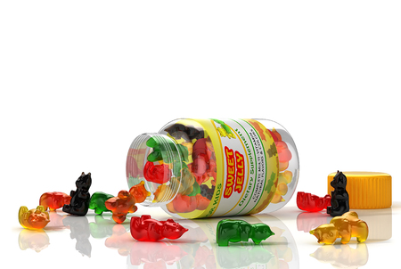 Kids multivitamins jellies poured from transparent container. 3D Illustration