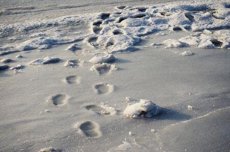 frozen river: footsteps on frozen river
