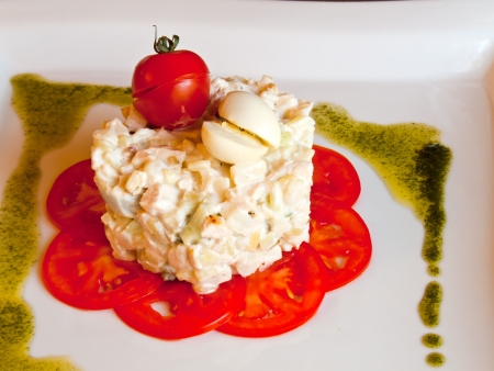 Salad of a one Frenchman with tomatoes and quail eggs photo