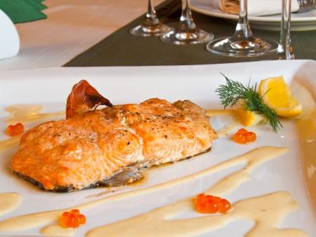 Salmon with caviar sauce an lemon