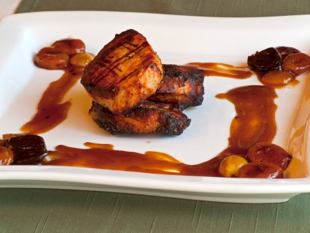 Pork with grapes, dried apricots and prunes