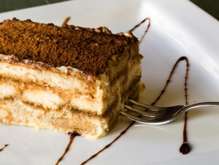 Tiramisu cake with a fork on a plate