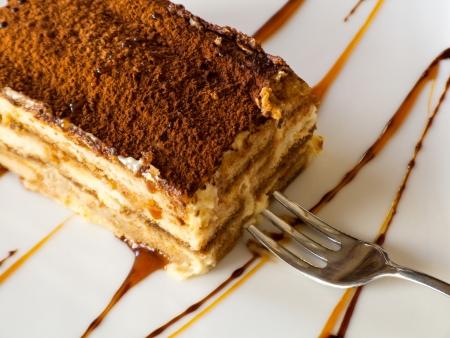 Tiramisu cake with a fork on a plate