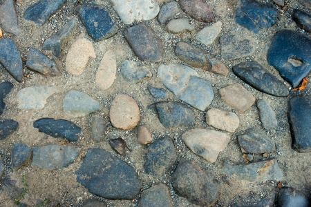 irregular texture of the old blue gray  stone wall outside Stock Photo