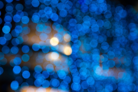 abstract background of blurred cool blue lights with warm yellow spots with bokeh effect Stock Photo