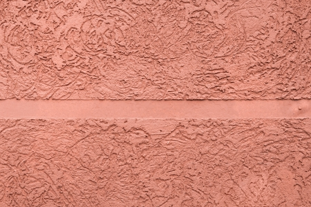 pink textured plaster with a smooth strip in the middle Stock Photo