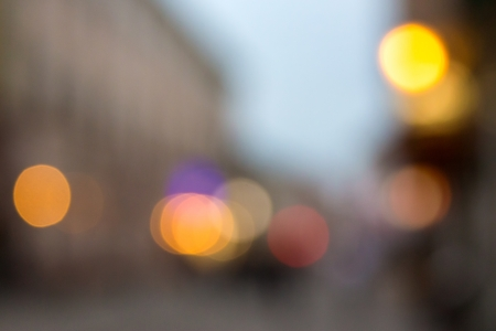 abstract cityscape background of blurred warm lights with cool violet spot with bokeh effect photo