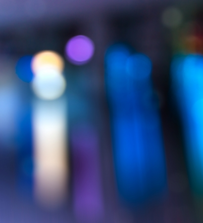 abstract evning blue background of blurred cool lights with cool violet spot with bokeh effect Stock Photo