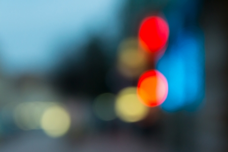 abstract cityscape background of blurred warm lights with hot red spot with bokeh effect Stock Photo