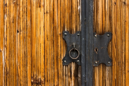 black door lock with a pen on a light wooden coating Varnishing photo