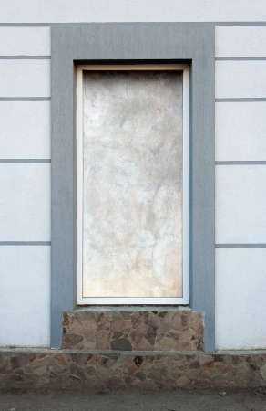 Frame of desolate immured new door with steps of cut stone