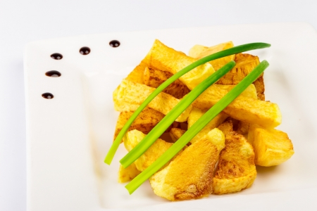 slide fried potatoes with shoots of green onions