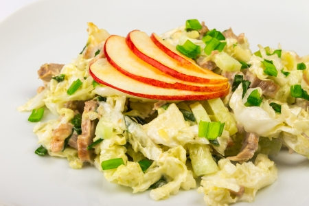 meat salad with cabbage, cucumbers and apples