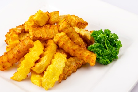 fried sliced ​​curly sticks potatoes chips with parsley