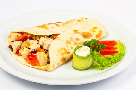 burrito with beans and chicken with fresh  cucumber and tomato