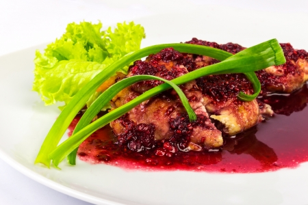 baked meat in a raspberry sauce with onion and lettuce