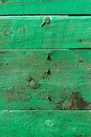 old green wooden boards with bent nails