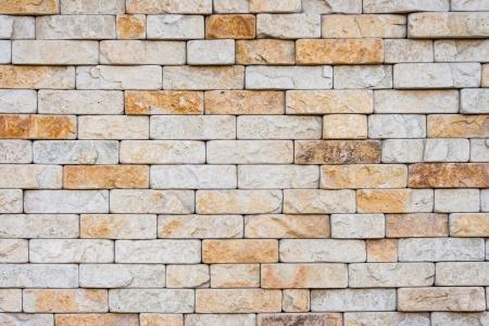not smooth masonry brick wall of sand color