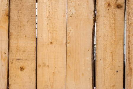 unpainted fence from wooden  curvy boards Stock Photo