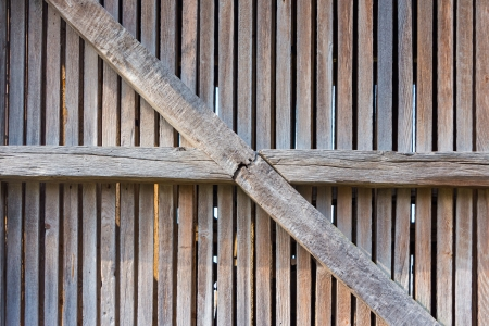 old enclosure from weathered wooden planks and beams