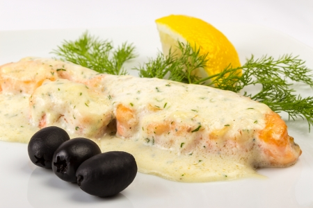 grilled fillet of red salmon, under French cream sauce, with Provencal herbs, filed with parsley lemon and three black olives