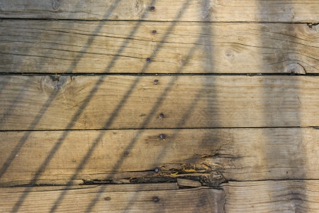 old cracked and weathered planks nailed