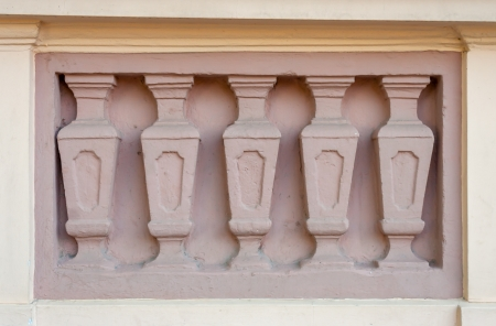 texture of five pink columns on the facade of an old building Stock Photo