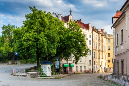 area of the old city near the park is still asleep in the morning light, wrapped by cobbled street  Stock Photo