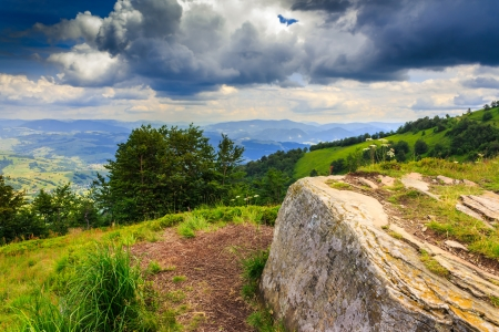 big white square stone on top of the mountain before the summer storm Stock Photo - 20866676