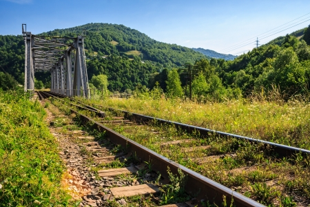 rail metal bridge in the mountains Stock Photo