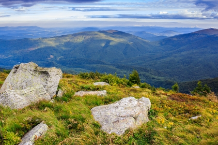 huge white stones in the rocky cliff at the top of the mountain Stock Photo