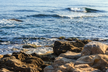 sea waves pick up speed closer to the side of the coastal cliffs Stock Photo