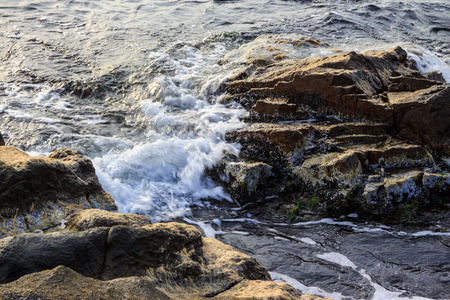 sea ​​wave attacks the boulders and is broken about them