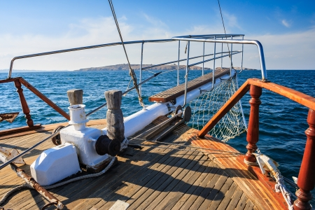 stem deck of a ship coming over the sea towards the island on a sunny day Stock Photo - 22693276