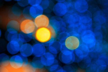 bokeh of yellow circle light on cool blue abstract blur