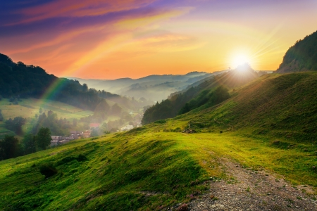 hillside: meadow on a hillside near the village to the summer cool morning mist