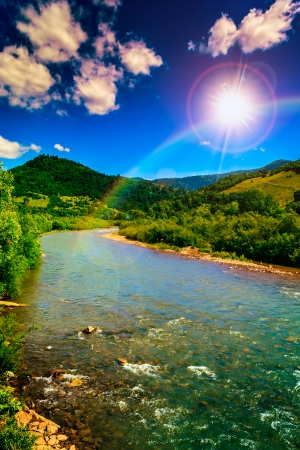 wild mountain river in mountains on a clear summer evening Stock Photo
