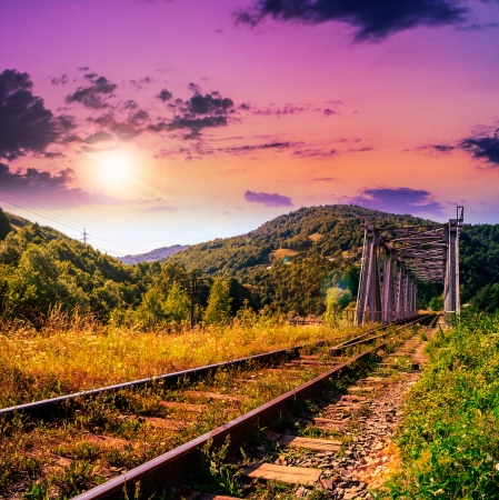 morning mountains landscape. rail metal bridge