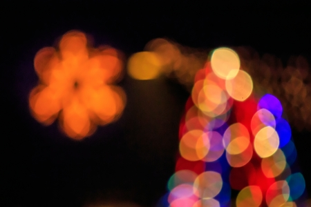 abstract background of blurred warm  and cool lights with warm background with red spots with bokeh effect