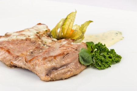 big and juicy piece of Bavarian roasted pork in a classic, authentic beer, white sauce. served with parsley and fezalis