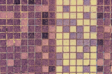 old mosaic tiles of different colors lined in vertical yellow pattern