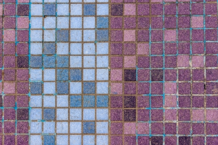 old mosaic tiles of different colors lined in vertical blue pattern