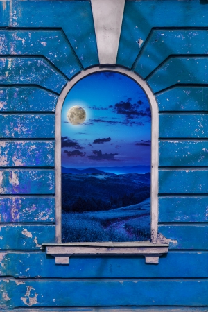 old window frame on the wall with picture of night moon landscape
