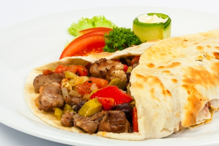 burrito with beans and beef with fresh  cucumber and tomato