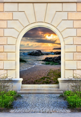 view of a wooden doorway: Frame of desolate immured door with picture of sea shore morning  and steps of cut stone Stock Photo