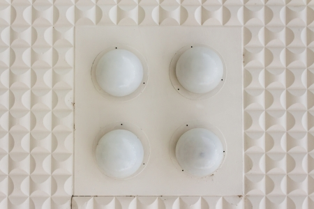 abstract geometric pattern of ellipse shapes plaster ceiling with circle lamp