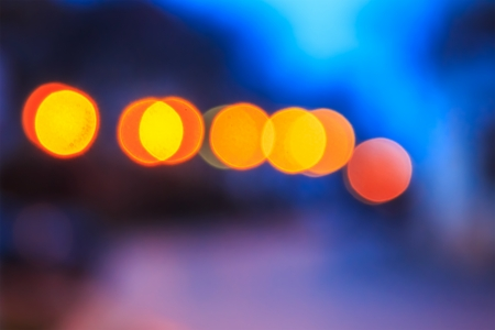 abstract background of blurred warm  lights with cool blue and purple background with bokeh effect
