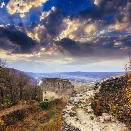 Stone wall of an old ruined castle in the mountains Stock Photo