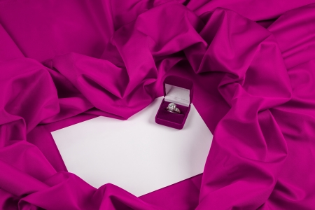 love card. purple jewel box with diamond ring on white paper and purple fabric