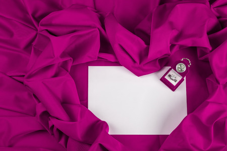 love card. purple jewel box with clock and diamond ring on white paper and purple fabric